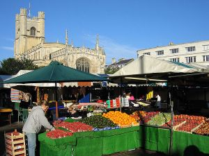 A stall being set-up early in the morning in the market square of Cambridge (UK).