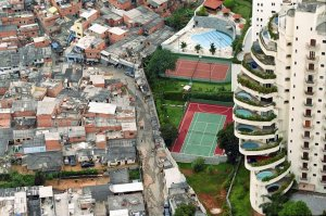 "Artificial segregation creates imbalanced cities. In this image, a favela borders an expensive condominium complex called ""Paradise City"""